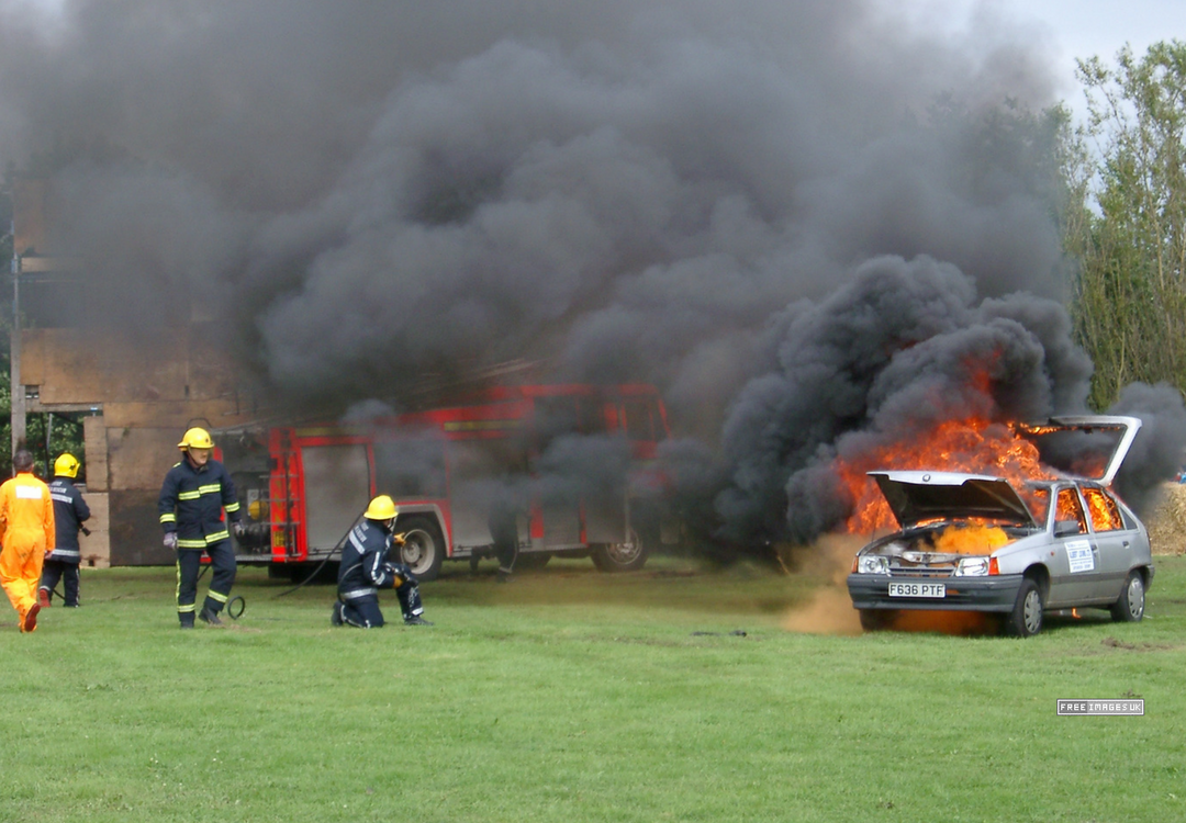 Firemen Fighting Car Fire